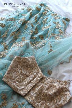 Gorgeous mint blue gold crop top lehenga set by Poppy Lane. Lehnga Dress, Lehenga Blouse, Lehenga Choli, Sarees, Indian Lehenga, Red Lehenga, Lehenga Designs, Saree Blouse Designs, Indian Wedding Outfits