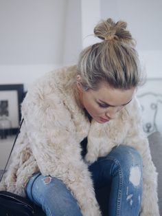 Camilla Pihl - faux fur jacket and ripped jeans.