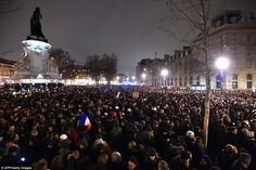 Demonstration: Protesters at the Place de la Republique  in Paris tonight,  following an attack by gunmen on the offices of Charlie Hebdo