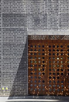 Unique Hotel Building with Metal Panels: Unique Perforated Building Silver Wall And Brown Wooden Entrance Door With Dream Downtown Hotel Let...