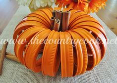 Mason Jar Lid Pumpkind DIY from The Country Cook. Ball Canning bands and jars