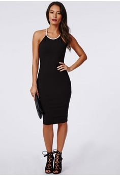 Embrace dainty details this season with this stunning silver embellished trim black bodycon dress. With stretch crepe fabric, figure flattering bodycon fit and chic silver embellishment surrounding the neckline which elegantly cross over to...