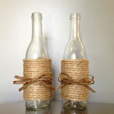 Small wine bottles wrapped in twine