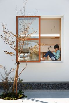 This beautifully linear house has been completed by mA-Style Architects in Shizouka, Japan.