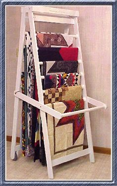 Working Quilt Rack is perfect for displaying and storing your quilts as well as providing an extension table for designing, cutting, sewing, and ironing your quilts. Craft Show Displays, Craft Show Ideas, Display Ideas, My Sewing Room, Sewing Rooms, Quilt Hangers, Quilt Racks, Quilting Frames, Quilting Ideas