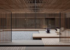 Hotel redesign by Neri&Hu featuring glass boxes and bronze columns.