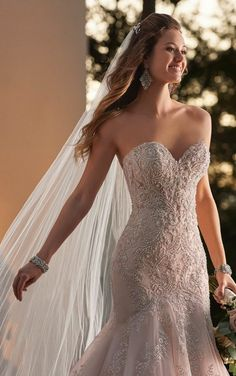 Youll own the aisle in this showstopper! Check out that detail!! Available at Spotlight Formal Wear! #SpotlightBridal