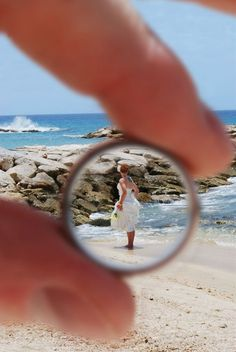 Capture a photo of the bride through the groom's wedding ring!