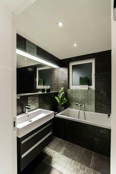 La salle de bains où la couleur prédominante est le noir