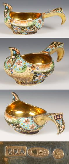 Russian silver gilt and shaded cloisonne enamel kovsh, 6th Artel, Moscow, circa 1908=1917. Of traditional form with raised prow and hook handle, the kovsh is decorated in vibrant multi-color scrolling floral and foliate motifs, the handle similarly decorated.