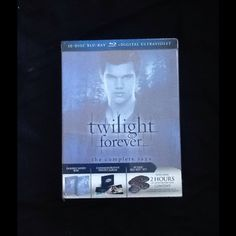 Twilight forever Selling the complete set of the twilight series. It has every movie including special features for each movie. It has double sided box, commemorative photo album, 10 disc set, and 2 hours of never seen content. It is blue ray. Never opened. I got two of these for Christmas and only need one. I took pictures of the opened one so you can see what it looks like. I am selling the none opened one. Accessories