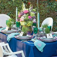 A lovely spring, garden table setting via @Southern Living .  Loving the color combos, linens and mix of different china patterns!