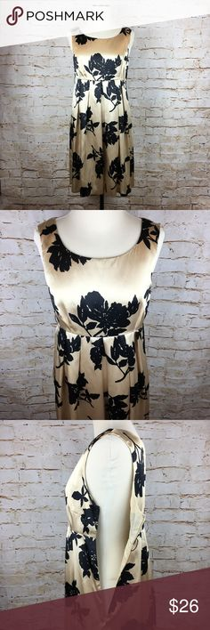 "🛍Michael Kors black gold floral cocktail dress MICHAEL by Michael Kors black and gold floral print cocktail dress size 8. Side zip, fully lined, 2 small belt loops on either side of dress to add a belt if you choose. Length from top of shoulder to bottom hem is approximately 34"". Armpit to armpit measured flat across is approximately 17.5"". EUC❤️ MICHAEL Michael Kors Dresses"