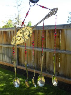 Wind chime with assorted whimsical silver by WhisperingMetalworks