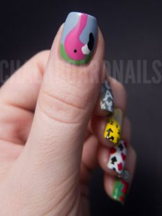 alice in wonderland nails. sweet.