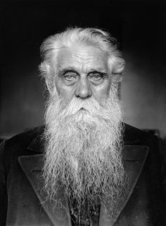 Old man's phote with long white beard posing in Black and White.