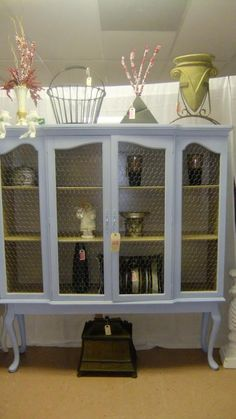 French Country Cabinet with a great pair of legs!