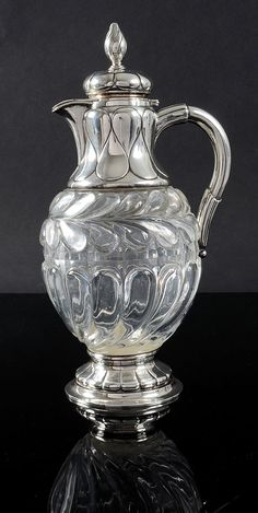 Carved crystal ewer by Fabergé, Saint-Petersburg, 1895. Mounted in silver with a décor of large gadroons, vermeil interior. Good condition. Stamped with Imperial Warrant.