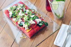watermelon . balsamic . olive oil . arugula . red onion . tomato . mango . goat cheese . sprouts