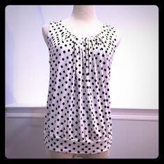 LOFT Polka Dot Sleeveless Top This LOFT polka dot sleeveless top looks great with a pop of color! Soft and drapey blend of rayon and spandex with a banded hem. In excellent condition with no holes, stains or tears. Worn once or twice. Please ask questions before purchase as all sales are final. LOFT Tops Tank Tops