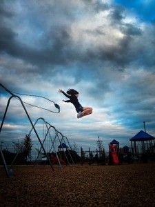 playground-swing-jump-girl-flying-portrait-photography