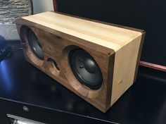 Walnut and pine Bluetooth speaker.