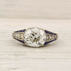 Love the large oval diamond, and the lines of sapphires on the sides.