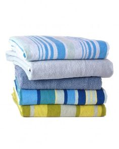 Over time, and with many washes, your bath towels will build up detergent and fabric softener residue, leaving them both unable to absorb as much water and smelling funky when they do.  Run them through the wash once with hot water and a cup of vinegar, then again with hot water and a half-cup of baking soda. When washing do not use fabric softener in washer, use one fabric sheet in dryer.
