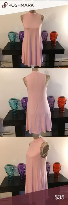 "BRAND NEW SOLID SLEEVELESS HIGH NECK SWING DRESS SLEEVELESS HIGH NECK SOLID SWING DRESS With side pockets 95%rayon 5% spandex  pale pink colored Measures approx S- chest width16 1/2"" length 23""  M -width18"" length 23""  L - 19"" width  23 1/2"" L  I DO NOT TRADE price firm unless bundled R.ROUGE Dresses Mini"