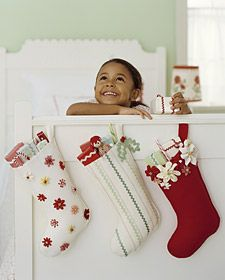 Decorate the felt before you cut out the stocking. Gluing rickrack in place makes it a snap to sew; dot trim's points with fabric glue, and, using a ruler to keep a straight line, lay rickrack on felt. Let dry. Sew with clear thread