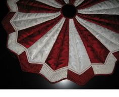 Designed in a complete round letting you rotate for even wear & lasting beauty. Machine quilted with red & white gimp. Metallic quilting on tips. All tree ski Diy Christmas Tree Skirt, Xmas Tree Skirts, Christmas Tree Skirts Patterns, Christmas Runner, Cool Christmas Trees, Christmas Sewing, Christmas Projects, Christmas Quilting, Christmas Patchwork