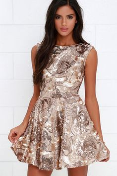What a delight you'll be as you make an entrance in the always shimmering Lighthearted Endeavors Rose Gold Sequin Skater Dress! Bold floral designs (in both shiny and matte sequins) top beige mesh fabric, beginning at a bateau neckline. Sleeveless bodice meets a set-in waist before flaring into a feminine skater skirt with hidden tulle for extra volume. Back keyhole with top button. Hidden back zipper and clasp.