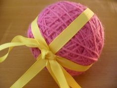 A magic yarn ball makes a unique and thoughtful gift for a crafty friend. Cute little trinkets wrapped up in a ball of yarn