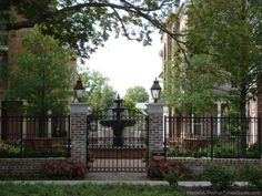 ironwork fences, gates, stone walls | The patios have beautiful details with ironwork, custom pavers, arbors ...