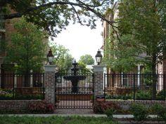 ironwork fences, gates, stone walls | The patios have beautiful details with ironwork, custom pavers, arbors ...
