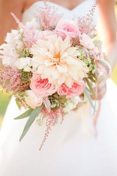 Pink flowers in a bouquet for a boho wedding