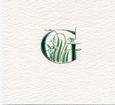 Handpainted Initial letter 'G' in dark green with snowdrops on watercolor paper.