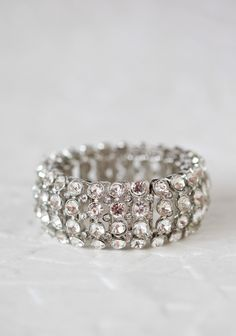 Light Up My Life Bracelet 32.99 at shopruche.com. Light-catching crystal clear rhinestones dazzle in this silver colored bracelet. Perfected with four rows of large sparkling rhinestones off-set by three rows of glistening smaller rhinestones.Elasticized band