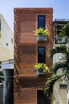 Designed by ALPES Green Design & Build and built in this state of the art luxury townhouse is like having your very own resort at home. Design Exterior, Brick Design, Facade Design, House Design, Building Facade, Green Building, Building Design, Green Facade, Brick Facade