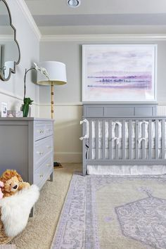 If you want to create a nursery that your little girl will love as she grows up, take a cue from this lavender and gray kid's room.