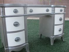 Like idea of painting the frame one color and the face of the drawers a different color. And having the handles match the frame.
