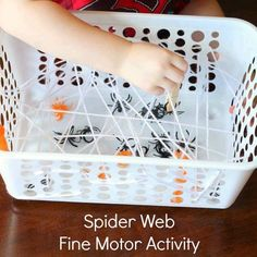 Spider web fine motor activity - weave white yarn through holes in a plastic container. Children use tweezers or clothespins to try and get the spider rings out halloween games Spider Web Fine Motor Activity Preschool Halloween Party, Theme Halloween, Preschool Crafts, Halloween Preschool Activities, Childrens Halloween Party, Halloween Decorations, Motor Activities, Autumn Activities, Toddler Activities