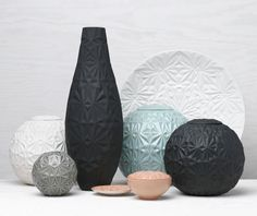 Dusty Diamonds is a collection of handmade stoneware with geometric relief patterns made by Swedish ceramicist Anna Elzer Oscarson. The limited edition pieces, like balls with lids, vases, and dishes, feature her signature faceted diamond-like surfaces that are full of dimension.