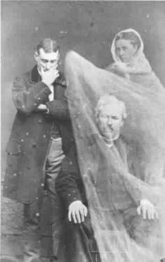 Victorian Spirit Photo by Solitaire Miles, via Flickr.  It appears the gentleman on the left side of the photo may be stifling a laugh.