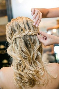 So flowing and so pretty is this half-up-half-down waterfall braided hairdo!  could hold the veil!