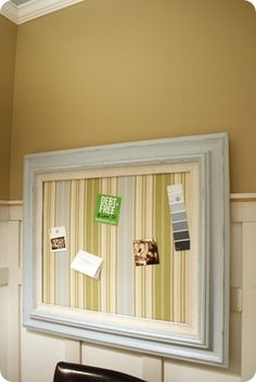 Magnetic DIY memo board using fabric covered sheet metal. So cute! From Thrifty Decor Chick.