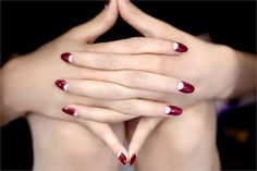 The Half-Moon Manicure Funky takes a front place with the half-moon nail. Made popular by seductress Dita Von Teese, this classic retro look gets an update from Priti's Red Riding Hood Tulip ($10.00).