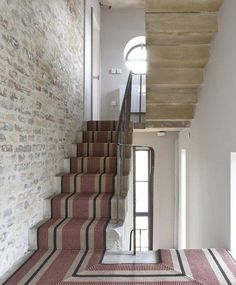 """100 linear metres of our flatweave runner was produced at an especially narrow width for the 10 flights of stairs within an East London water tower, renovated by Leigh Osborne and featured in the episode of Channel """"Grand Designs"""". Architecture Details, Interior Architecture, Interior And Exterior, Grand Designs Water Tower, Style At Home, Entry Stairs, Stair Landing, Carpet Stairs, Windows"""