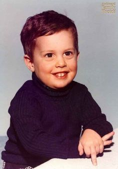 Slyly trolling his parents at a young age. | 21 Kids Who Shut Down Picture Day