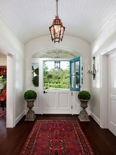 Dutch door, Persian runner, lantern...and that view!